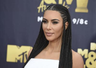 Kim Kardashian West locks arms with prison reform warriors