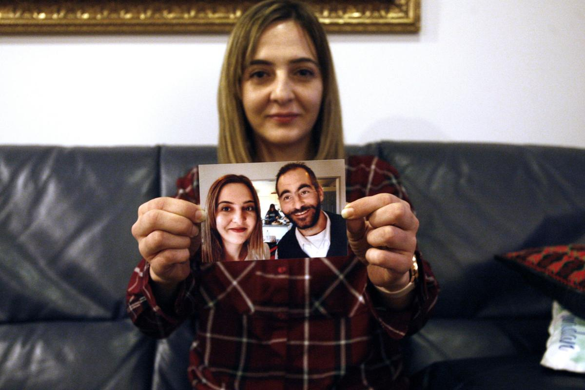 Aya Al-Umari, whose brother Hussein was killed in the Christchurch mosque attacks, poses, holding a photo of herself and her brother, in Christchurch, New Zealand. She is among 200 survivors and relatives from the Christchurch mosque shootings who are traveling to Saudi Arabia as guests of King Salman for the Hajj pilgrimage, a trip many hope will help them to heal.—AP Photo/Nick Perry