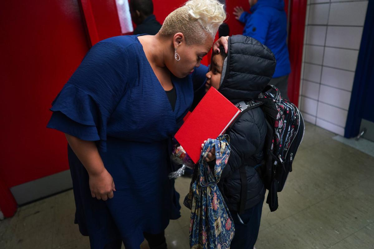 Brandi Vardiman greets fourth-grader