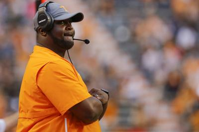 In this April 13 file photo, Tennessee assistant coach Tee Martin watches the Orange and White spring football game in Knoxville, Tenn. Tennessee's wide receivers savor the opportunity to play for their new position coach because they appreciate what Tee Martin accomplished during his own playing career. Martin was the starting quarterback on Tennessee's 1998 national championship team and is back at his alma mater trying to help the Volunteers become competitive again in the Southeastern Conference.— C.B. Schmelter/Chattanooga Times Free Press via AP, File