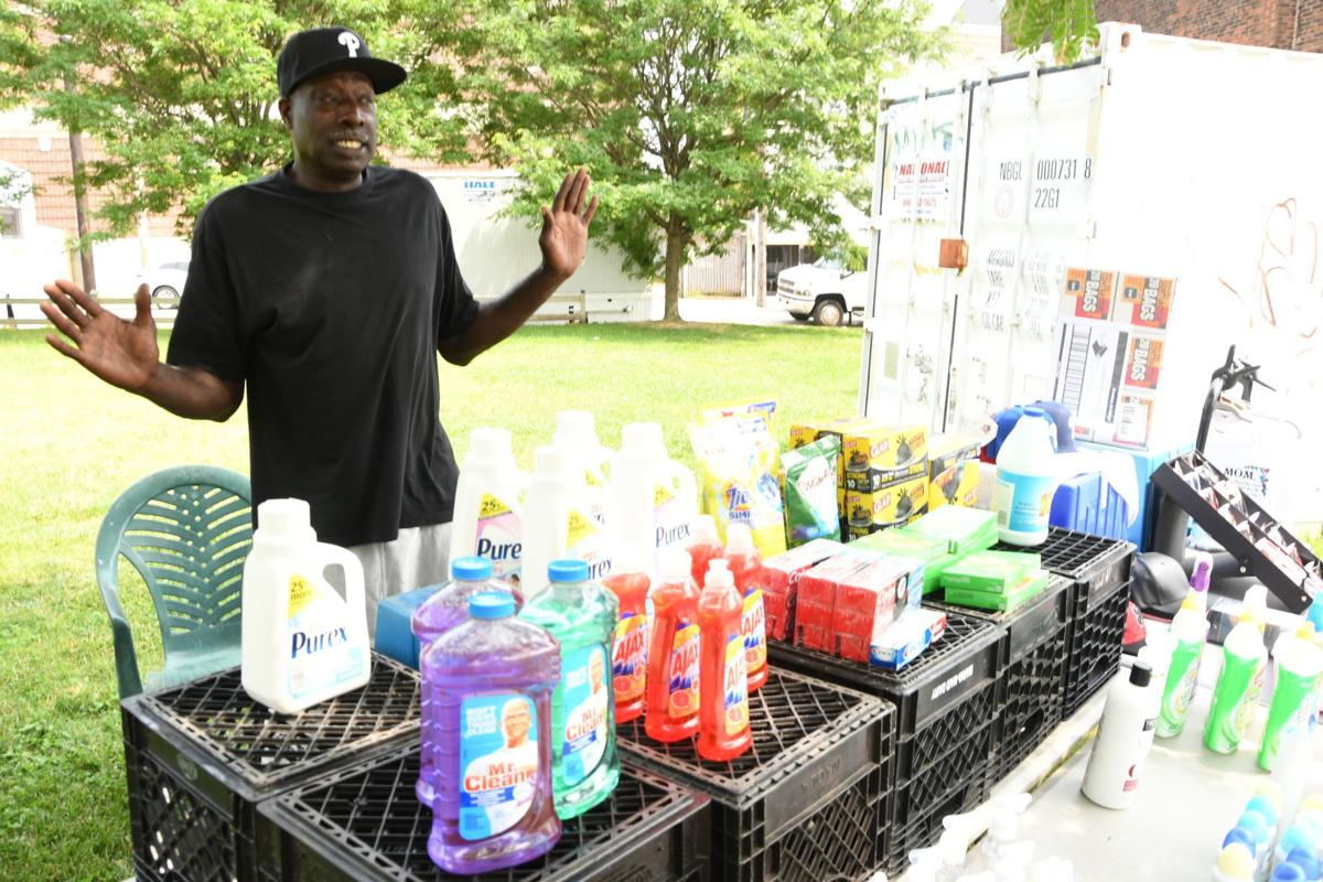Former Overbrook High, Drake University and NBA standout Lewis Lloyd is a licensed vendor who operates a thriving goods stand on 52nd Street near Lancaster Avenue. — PHOTO BY ABDUL R. SULAYMAN/TRIBUNE CHIEF PHOTOGRAPHER