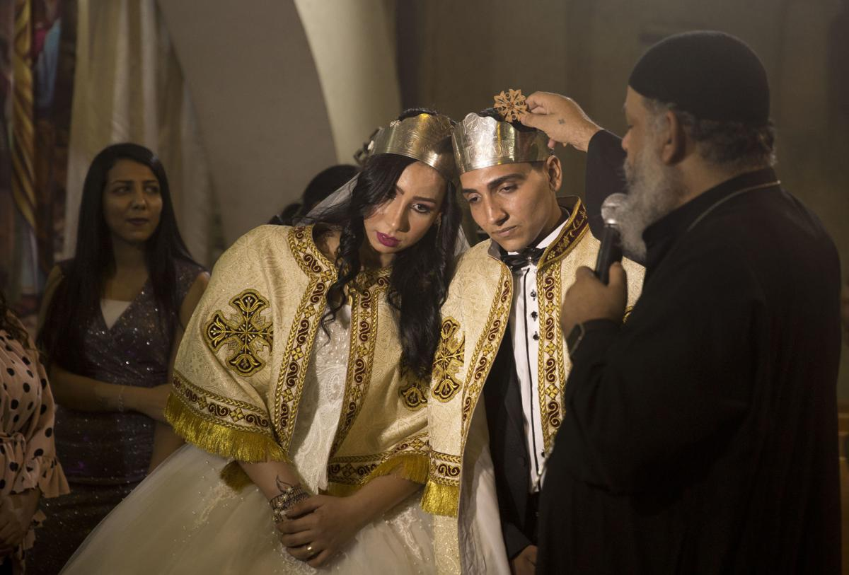 In this June 15 photo, a Coptic priest blesses an Egyptian couple during their wedding in St. Samaan's Church, in the predominantly Christian Manshiyat Nasser area of Cairo.— AP Photo/Maya Alleruzzo