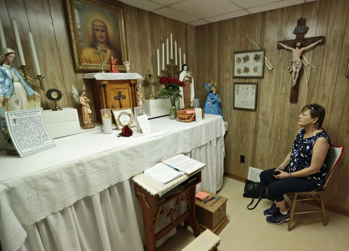 Marge Ruminski, from Parma, Ohio, sits in the chair where Rhoda Wise was visited by Jesus Christ in front of the altar in Canton, Ohio.—AP Photo/Tony Dejak