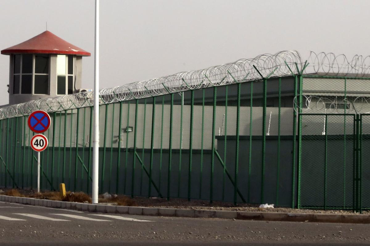 In this Monday, Dec. 3, 2018, file photo, a guard tower and barbed wire fences are seen around a section of the Artux City Vocational Skills Education Training Service Center in Artux in western China's Xinjiang region. This is one of a growing number of internment camps in the Xinjiang region, where by some estimates over 1 million Muslims have been detained, forced to give up their language and their religion and subject to political indoctrination. — AP Photo/File