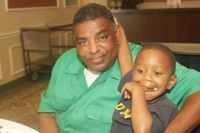 Malik Aziz with his grandson.