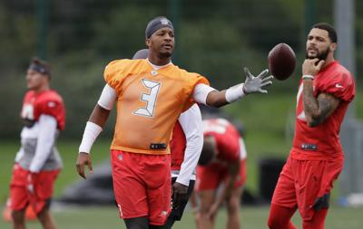 Tampa Bay Buccaneers quarterback Jameis Winston throws the ball during a practice session at Blackheath Rugby Football Club ground in London on Friday. The Buccaneers are preparing for an NFL regular season game against the Carolina Panthers in London on Sunday. — AP Photo/Kirsty Wigglesworth