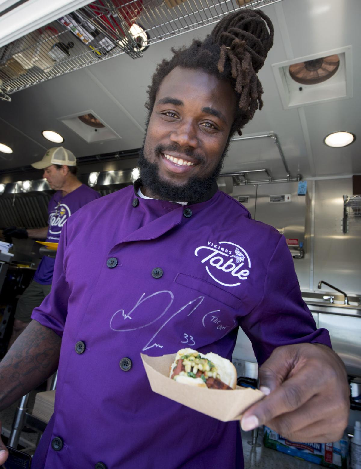Minnesota Vikings running back Dalvin Cook serves food from the Vikings Table. —AP Photo/Andy Clayton- King