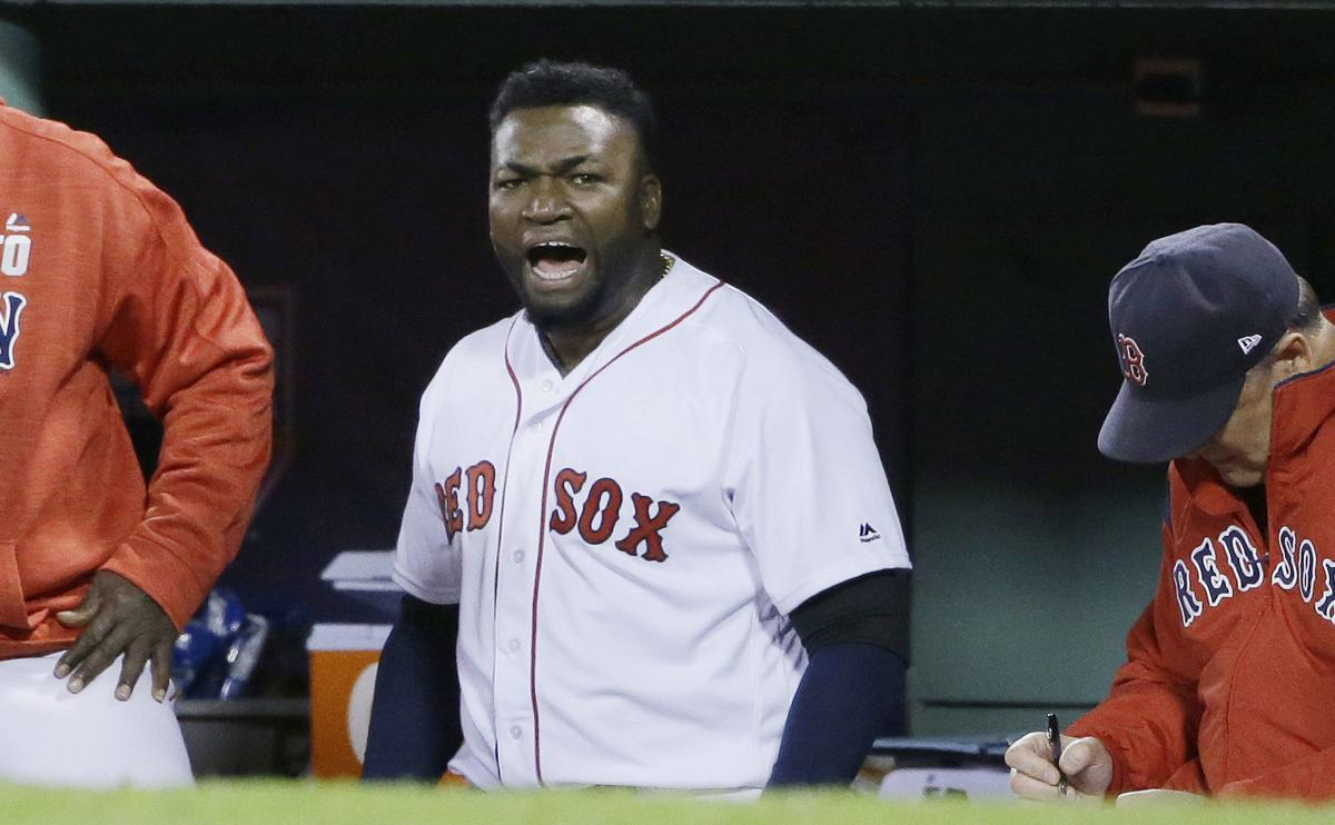 In this Oct. 10, 2016, file photo, Boston Red Sox designated hitter David Ortiz encourages the crowd from the dugout during the eighth inning in Game 3 of baseball's American League Division Series against the Cleveland Indians in Boston. — AP Photo/Elise Amendola, File