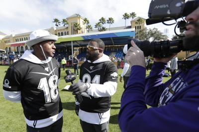 AFC running back Mark Ingram, right, of the Baltimore Ravens interviews Matthew Slater (18) of the New England Patriots after a practice for the NFL Pro Bowl football game on Wednesday in Kissimmee, Florida. — AP Photo/John Raoux