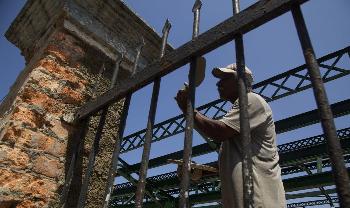 Railroad worker Norberto Rosales repairs a gate at the central train station in Havana, Cuba. Workers have been restoring Havana's main rail terminal, an eclectic structure built in 1912, with four floors and a mezzanine, for over 10 years. — AP Photo/Ismael Francisco