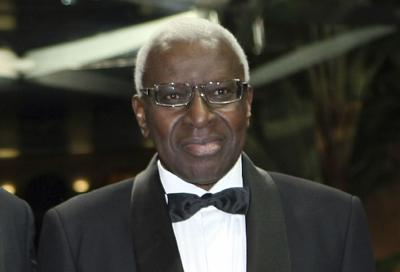 In this Nov.12, 2011file photo, President of the IAAF (International Association of Athletics Federations) Lamine Diak poses at 2011 World Athletics Gala Awards, in Monaco. French legal authorities have decided to hold a trial for Lamine Diack, once one of the most influential men in Olympic sport, who was disgraced by investigations that uncovered corruption, extortion and doping cover-ups during his 16-year reign as head of the world governing body of track and field. — AP Photo/Claude Paris, File