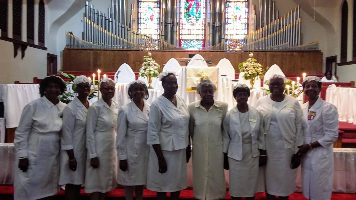 """St. Matthew AME Church has six boards of stewardesses, each responsible for two months of Holy Communion Service duties. The featured group are members of, """"Stewardess Board # 2, from left, Enid Conolly, Dawn Gravely, Hattie Cruger, Barbara Lewis, the current Board #2 President, Gwen Johnson-Stokes, St. Matthew AME Church Stewardesses Board President, Eunice McQueen, Lula Acey, Tanya Brown and Jacquie Brodie-Davis."""
