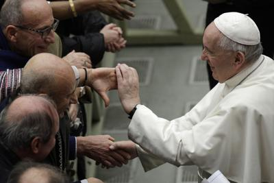 Pope Francis is greeted by faithful during the weekly general audience at the Vatican on Wednesday. — AP Photo/Gregorio Borgia