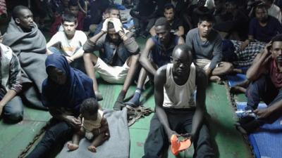 Migrants on ship