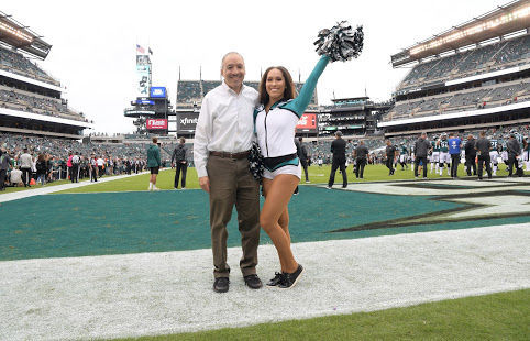 Philadelphia Tribune sportswriter Donald Hunt and his daughter Arielle share a moment before a Philadelphia Eagles home game. —TRIBUNE PHOTOS BY MARISSA WEEKES MASON