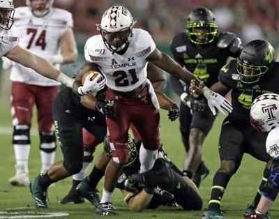 Temple running back Jager Gardner (21) picks up yardage against South Florida on Thursday in Tampa, Florida. — AP Photo/Chris O'Meara