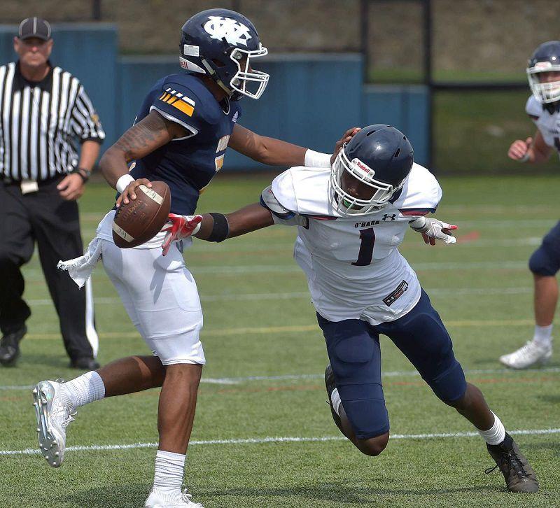 West Catholic's senior quarterback Zaire Hart-Hawkins, left, was very elusive. — SUBMITTED PHOTO