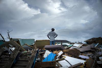A man stands on the rubble of his home in the Haitian Quarter, after the passage of the Hurricane Dorian in Abaco, Bahamas on Sept. 16. Dorian hit the northern Bahamas on Sept. 1, with sustained winds of 185 mph unleashing flooding that reached up to 25 feet  in some areas. — AP Photo/Ramon Espinosa