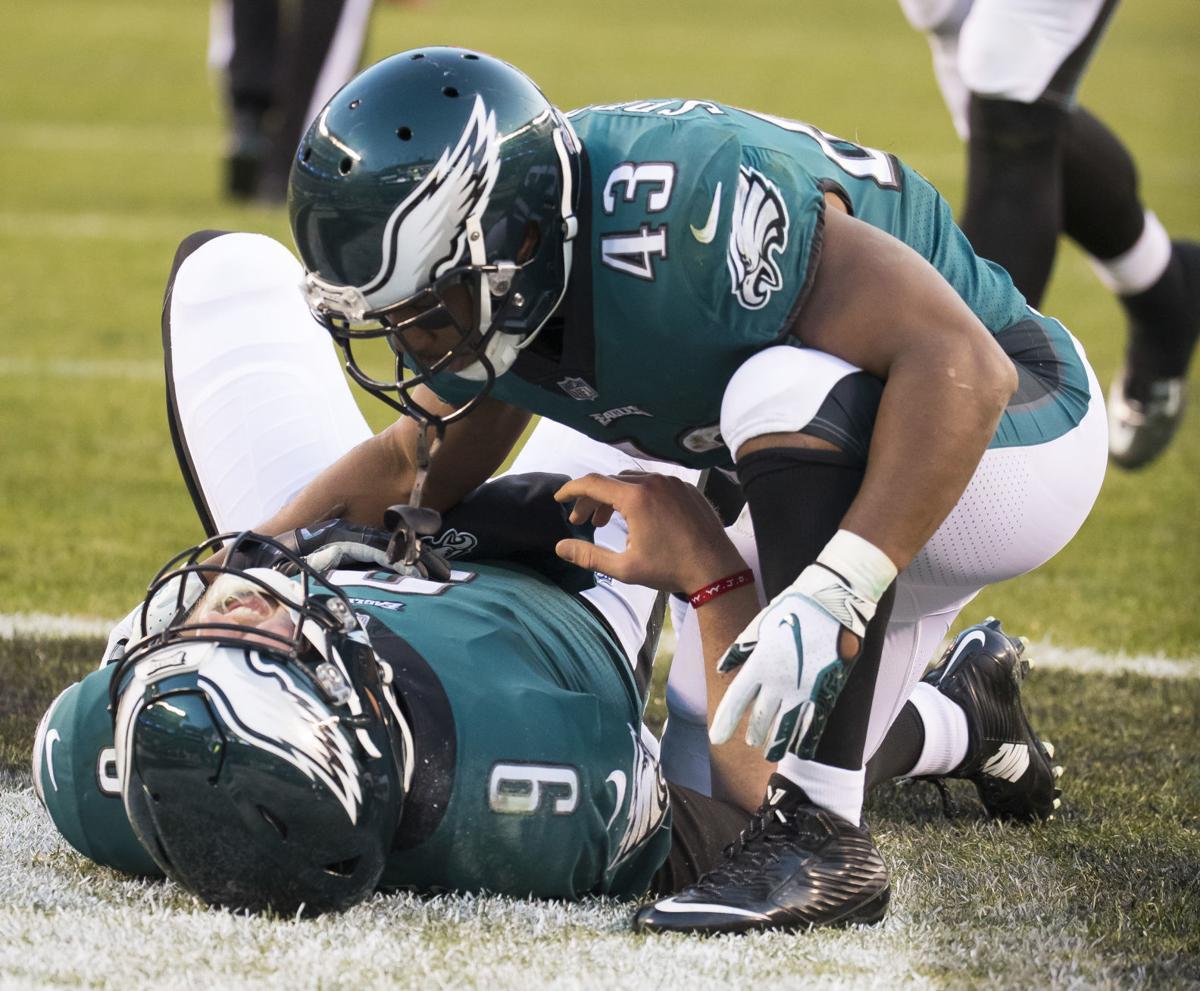 Darren Sproles and Nick Foles. Philadelphia Eagles running back Darren  Sproles (43) leans over quarterback ... 0137967dc