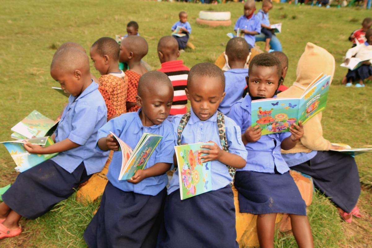 2021 05 18-provided-rwanda-preschoolers receive books girls read