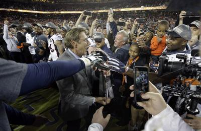 In this Feb. 7, 2016, file photo, Joe Namath, MVP of Super Bowl III, carries the Lombardi Trophy onto the field for the postgame ceremony after the NFL Super Bowl 50 football game between the Denver Broncos and the Carolina Panthers, in Santa Clara, Calif. Just over 50 years ago, halfway through the history of the NFL, the New York Jets completed one of the most unexpected championship seasons in the history of the sport when Namath helped engineer a Super Bowl victory over the heavily favored Baltimore Colts. — AP Photo/Julie Jacobson, File