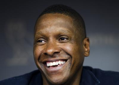 Toronto Raptors team president Masai Ujiri speaks to the media during an NBA basketball press conference in Toronto. Ujiri has barely paused since the Raptors won the NBA championship in June. Much of his time has been devoted to Giants of Africa, his passion project since 2003. The tour added Somalia and South Sudan to the schedule this summer, two countries still staggering from civil wars. — Nathan Denette/The Canadian Press via AP, File