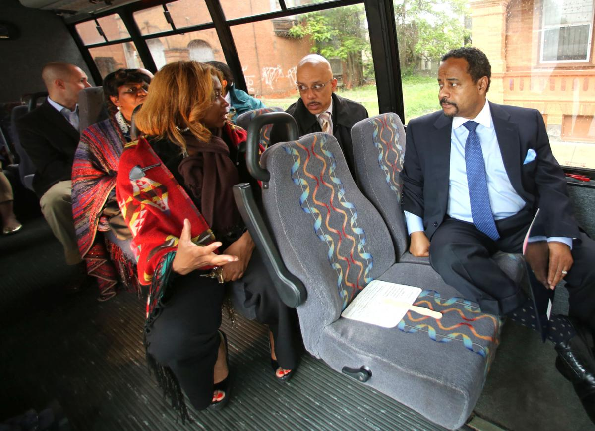 state sen. vincent hughes, center, during tour of housing in west philadelphia and strawberry mansion