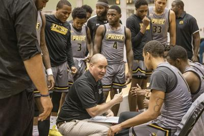 CCP head coach Joe Rome (center) gives direction to his players, seated from left, Tyreek Johnson (#1), Amir Woods (#3) and Cameron Gardner (#22). — SUBMITTED PHOTO