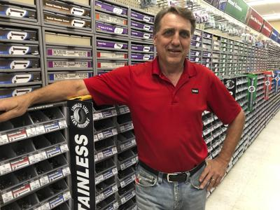 In this July 31 photo, business owner Jeff Hinz poses for a photo at his hardware store in Bismarck, North Dakota. North Dakotans will be allowed to shop on Sunday morning for the first time since statehood. But Hinz said he will continue to be closed on Sunday mornings to attend church. — AP Photo/James MacPherson