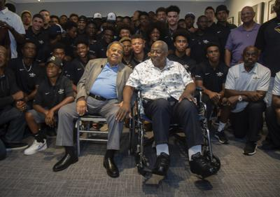 Andrew Young, left, and Hank Aaron, left, pose for photos with the participants at the end of the Hank Aaron Invitational at SunTrust Park in Atlanta on Friday. — Steve Schaefer/Atlanta Journal-Constitution via AP