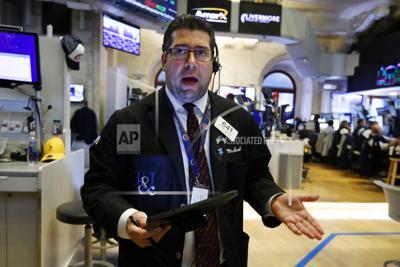 Trader Michael Capolino works on the floor of the New York Stock Exchange on Thursday. — AP Photo/Richard Drew