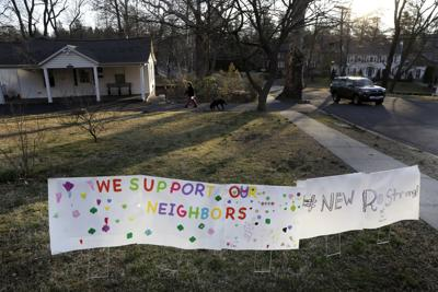 A sign showing support for residents is displayed on a lawn in New Rochelle, N.Y. State officials are shuttering several schools and houses of worship for two weeks in the New York City suburb and sending in the National Guard to help with what appears to be the nation's biggest cluster of coronavirus cases, Gov. Andrew Cuomo said. — AP Photo/Seth Wenig