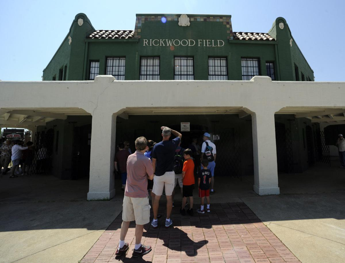 Fans line up to enter Rickwood Field, America's oldest baseball park, for a Double-A game between the Birmingham Barons and the Montgomery Biscuits in Birmingham, Ala. on Wednesday. — AP Photo/Jay Reeves