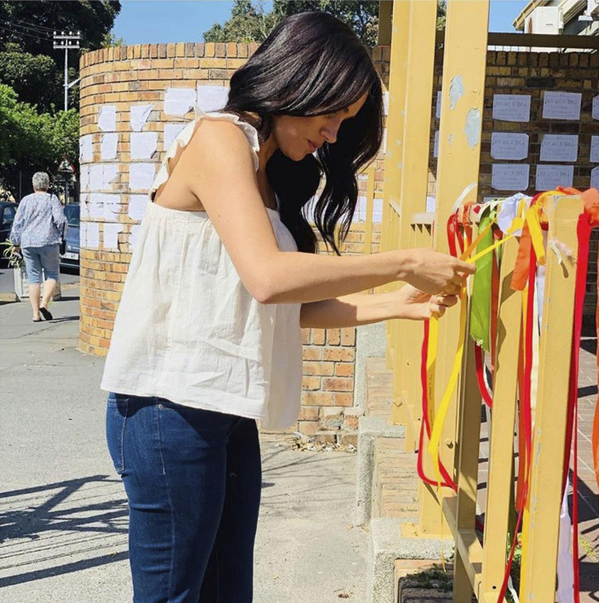 "Britain's Meghan, the Duchess of Sussex visits the memorial to a murdered South African student as a ""personal gesture"" after ""closely following the tragic story."" In a quiet visit, Meghan tied a ribbon to the memorial at the post office where university student Uyinene Mrwetyana was attacked.  — Sussex Royal via AP"