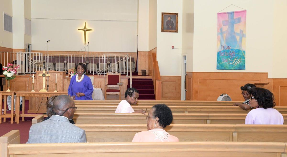 Pastor of New Horizon Baptist Church, the Rev. Flora Anderson, standing left, speaks during church service.  TRIBUNE PHOTOS BY MARISSA WEEKES MASON