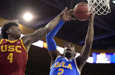 In this Feb. 28 file photo, UCLA forward Cody Riley, right, grabs a rebound away from Southern California guard Kevin Porter Jr. during the first half of an NCAA college basketball game in Los Angeles. The NCAA's Board of Governors is urging Gov. Gavin Newsom not to sign a California bill that would allow college athletes to receive money for their names, likenesses or images. — AP Photo/Mark J. Terrill, File