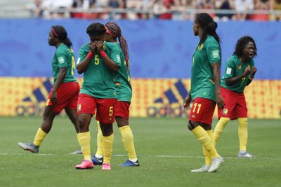 Cameron players react after a VAR decision that ruled out Cameroon's Ajara Nchout's goal for offside during the Women's World Cup round of 16 soccer match between England and Cameroon at the Stade du Hainaut stadium in Valenciennes, France on Sunday. — AP Photo/Michel Spingler