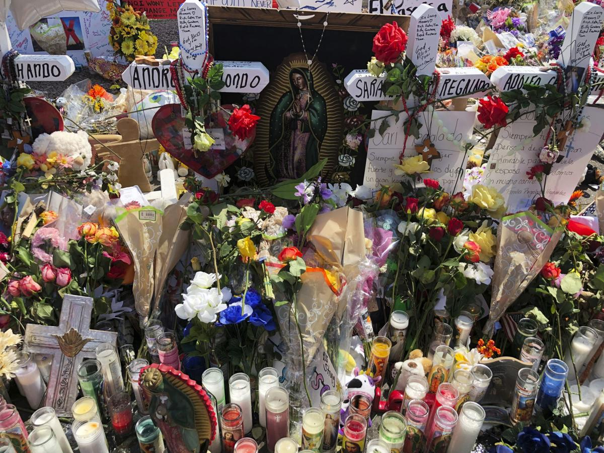 In this Aug. 6 photo, an image of the Virgin Mary sits among flowers at a makeshift memorial in El Paso. — AP Photo/Astrid Galván