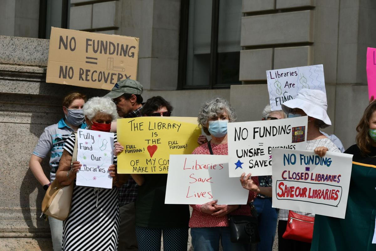 Protesters for more Free Library money 2021