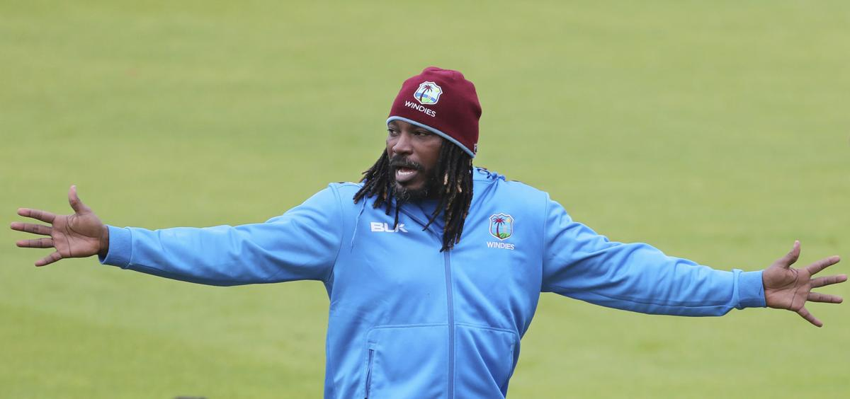 TRAINING HARD  West Indies' Chris Gayle gestures to his teammates during a training session ahead of their Cricket World Cup match against India at Old Trafford in Manchester, England on Wednesday. — AP Photo/Aijaz Rahi