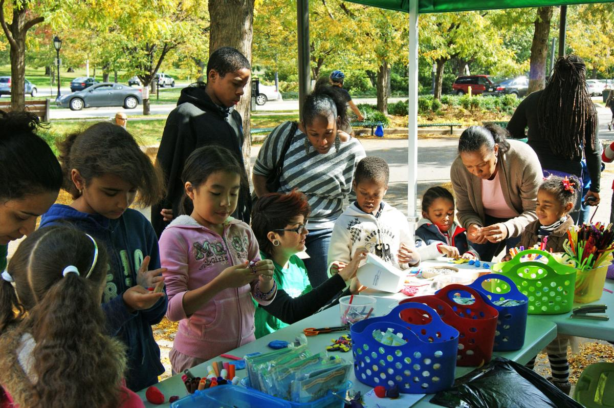 "Children play in Sculpture Zoo in Logan Circle"""