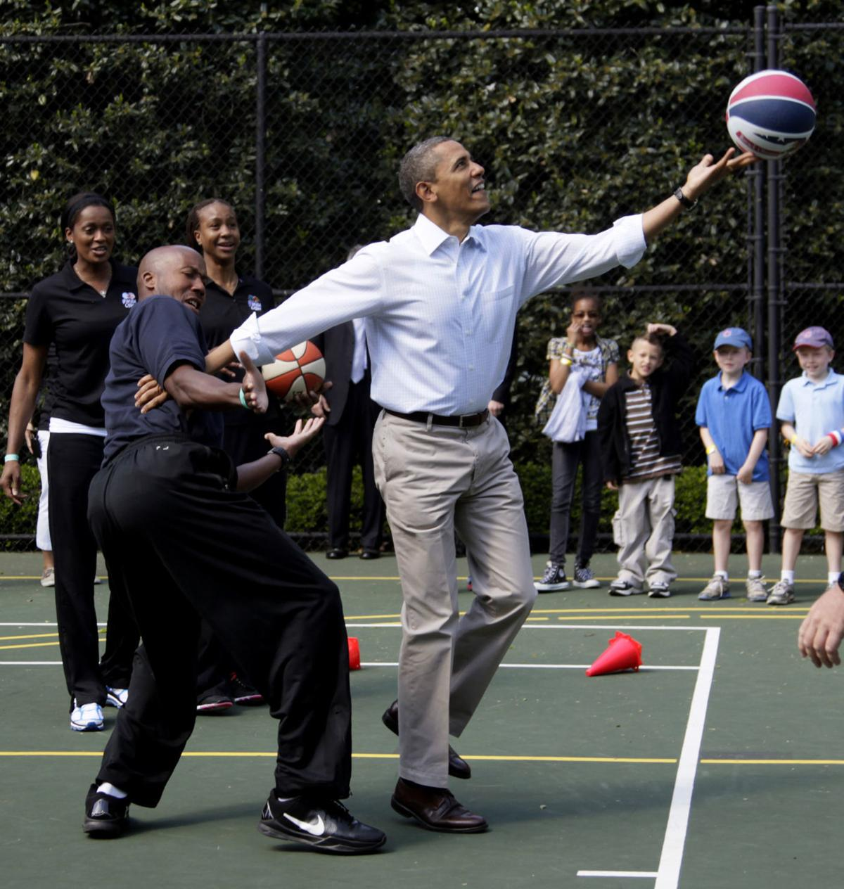 In this April 9, 2012, file photo, President Barack Obama plays basketball with former NBA basketball player Bruce Bowen during the annual White House Easter Egg Roll at the White House in Washington.— AP Photo/Carolyn Kaster, File