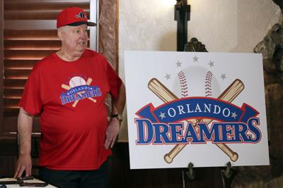 Pat Williams, co-founder of the NBA Orlando Magic basketball team, wears a T-shirt and hat with the logo 'Orlando Dreamers' while speaking at a news conference to announce a campaign to bring a Major League Baseball team to Orlando on Wednesday in Orlando, Florida. — AP Photo/John Raoux