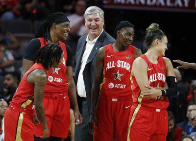 Team Wilson head coach Bill Laimbeer, center, laughs with his team during the second half of a WNBA All-Star basketball game against Team Delle Donne on July 27 in Las Vegas. — AP Photo/John Locher