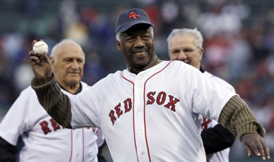 """In this April 19, 2009, file photo, Boston Red Sox great Elijah """"Pumpsie"""" Green throws out a ceremonial first pitch for the Red Sox's baseball game against the Baltimore Orioles in Boston. Green, the first black player on the Red Sox, has died. He was 85. A Red Sox spokesman confirmed his death Wednesday, July 17, 2019. — AP Photo/Charles Krupa, File"""