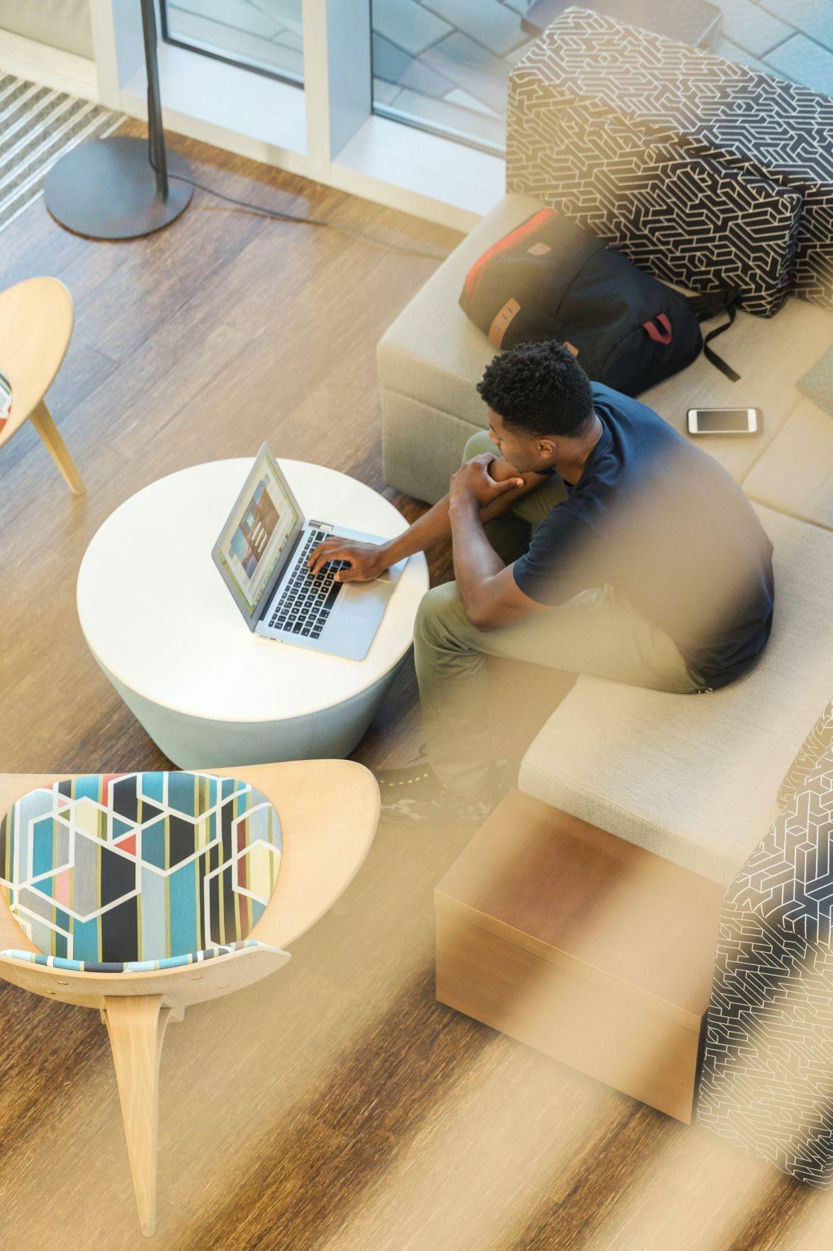 man on laptop overlook
