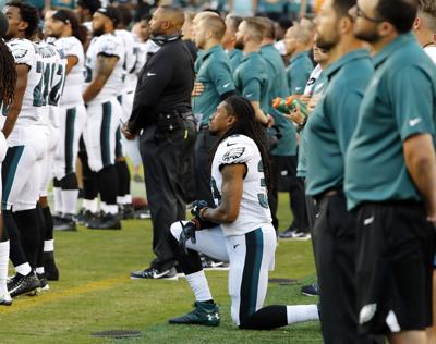 c987efe700158 Dolphins Eagles Football. Philadelphia Eagles cornerback Ron Brooks kneels during  the National Anthem before ...