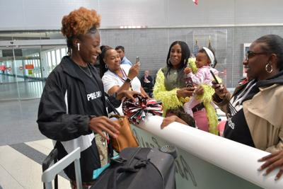 International track star Nia Ali, left, returned to Philadelphia on Thursday. — PHOTO BY ABDUL R. SULAYMAN/TRIBUNE CHIEF PHOTOGRAPHER