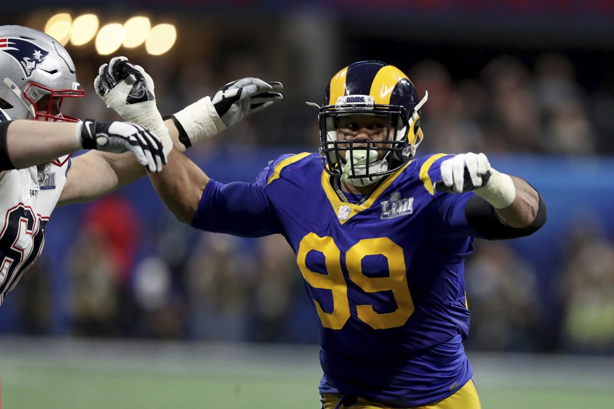 In this Feb. 3 file photo, Los Angeles Rams Aaron Donald (99) rushes against the New England Patriots during Super Bowl 53 in Atlanta. Donald, the two-time reigning defensive player of the year, is always searching for out-of-the-box ways to improve his game. That's why the Rams defensive lineman trained with knives again this offseason. That's right, knives, of the plastic variety, of course, in order to improve his eye-hand coordination. His real driving force? That loss to the Patriots in the Super Bowl. — AP Photo/Gregory Payan, File