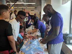 Malcolm Jenkins, right, lends a hand to youngsters participating in a six-week Science, Technology, Engineering, Arts and Athletics and Math (STEAM) summer program for middle school students at Drexel University. — SUBMITTED PHOTO